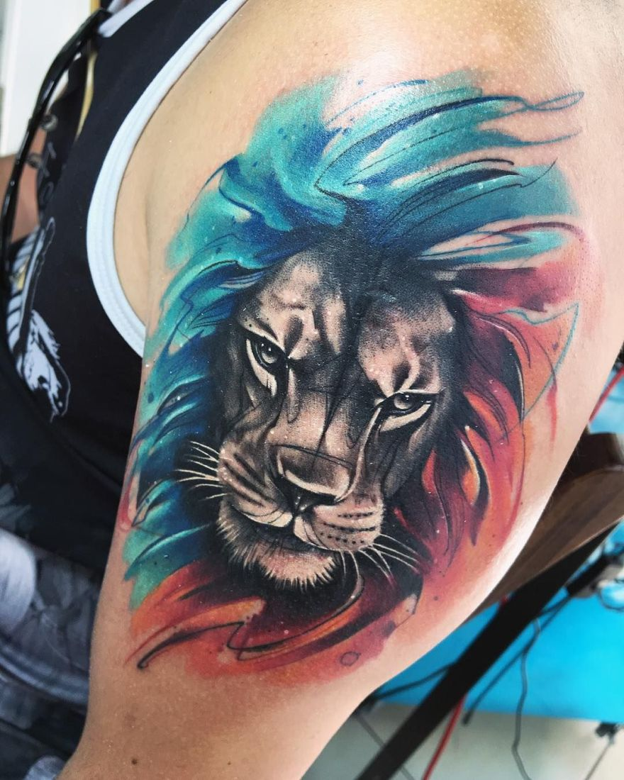 Black, Blue, and Red Lion Tattoo