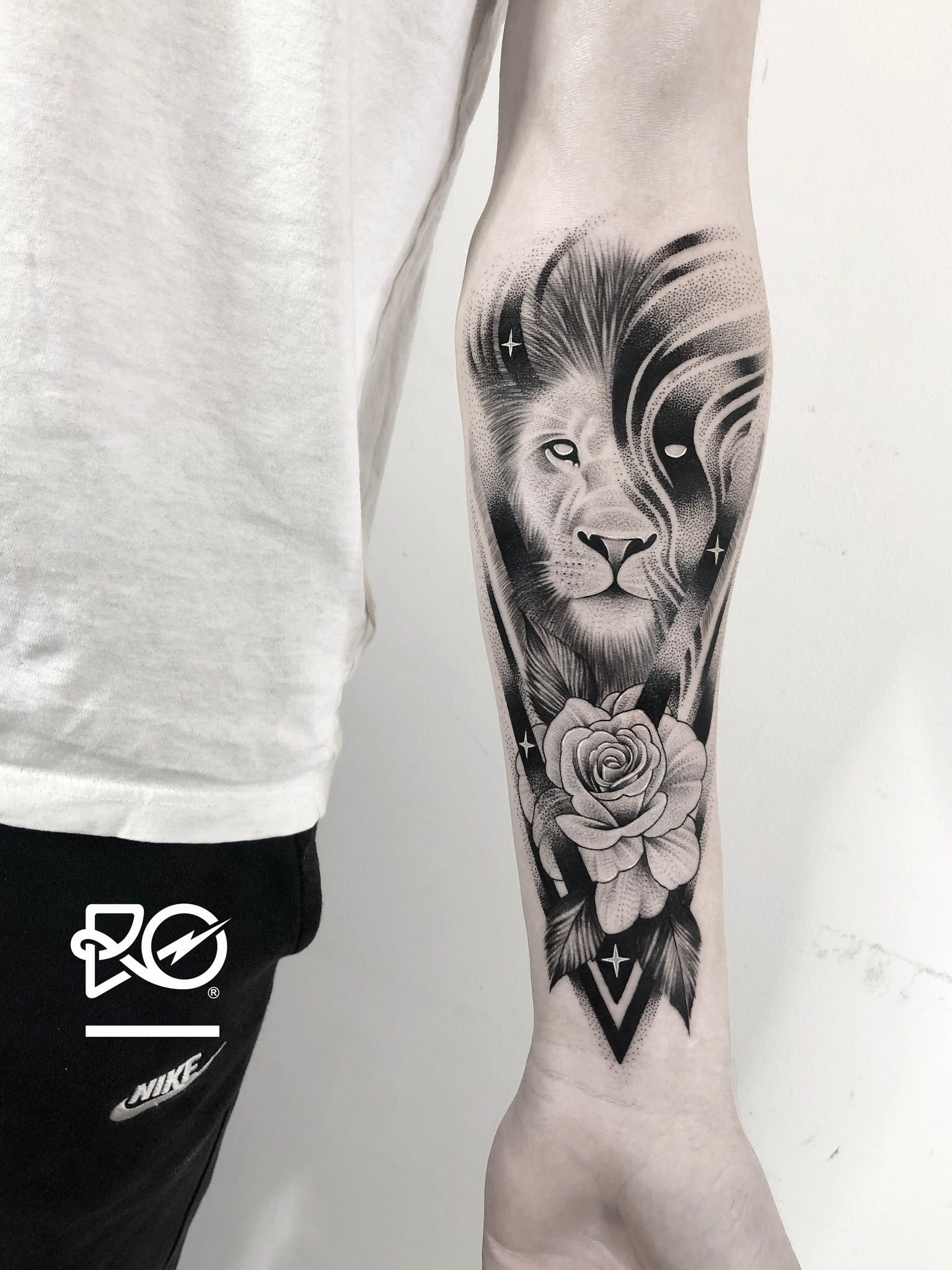 Mystical Lion and Rose Tattoo on Forearm