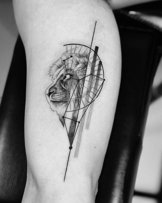 Grayscale Lion Head Tattoo with Zodiac Elements