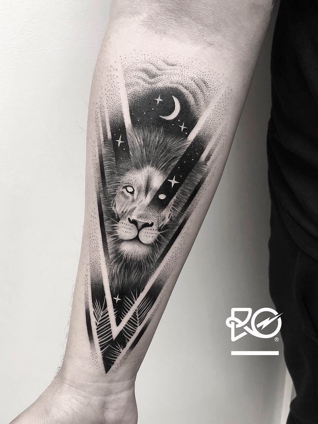 Lion in the Sky with Feathers Tattoo