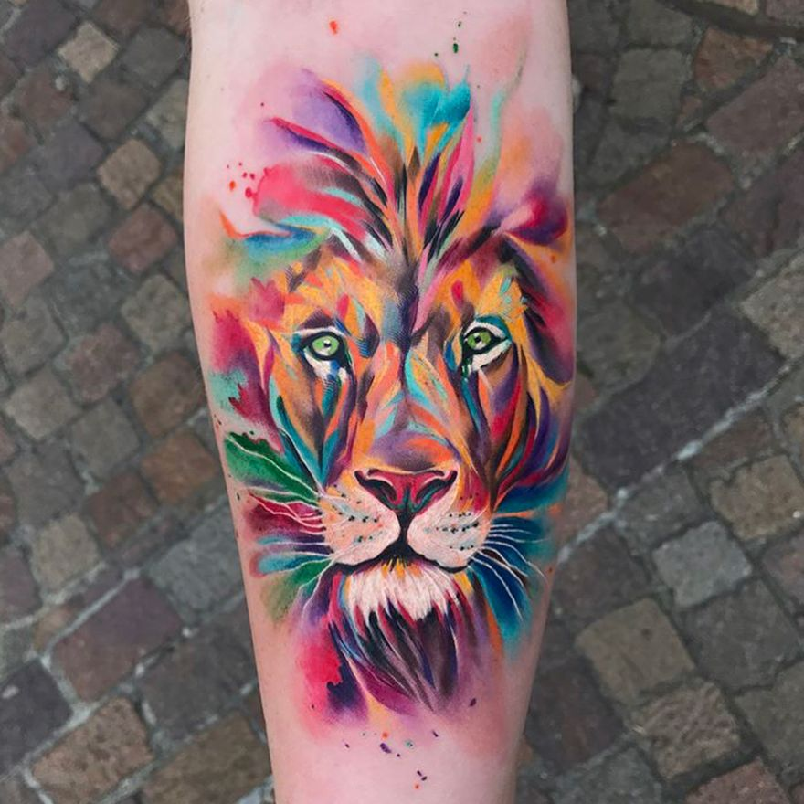 Brightly Colored Watercolor Style Lion Face Tattoo