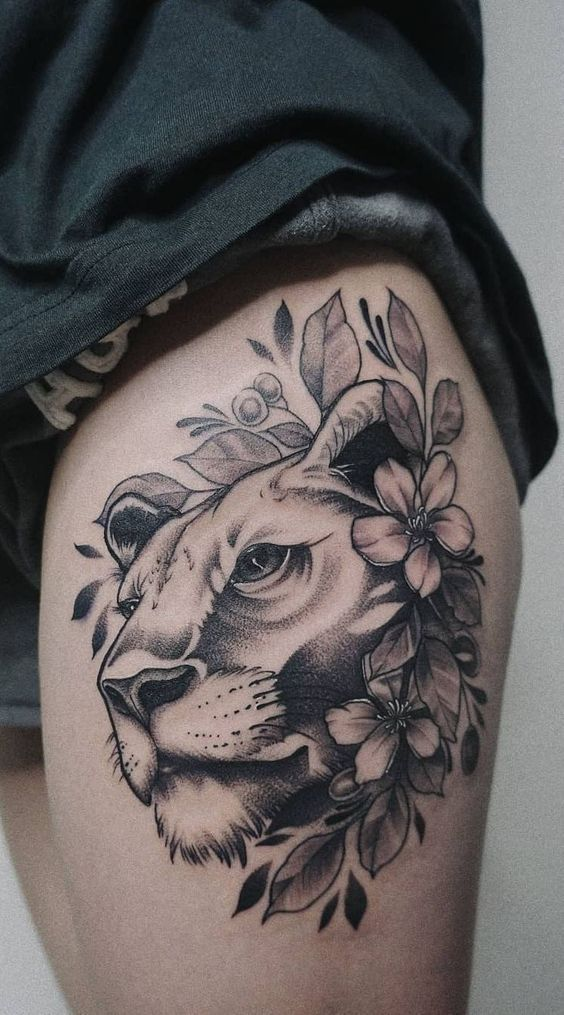 Lioness Head with Flowers Tattoo in Grayscale