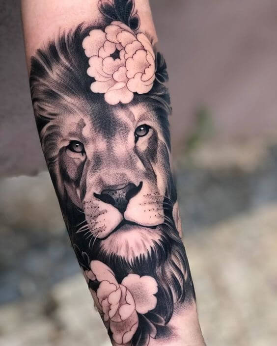 Black and White Lion Tattoo with Flowers
