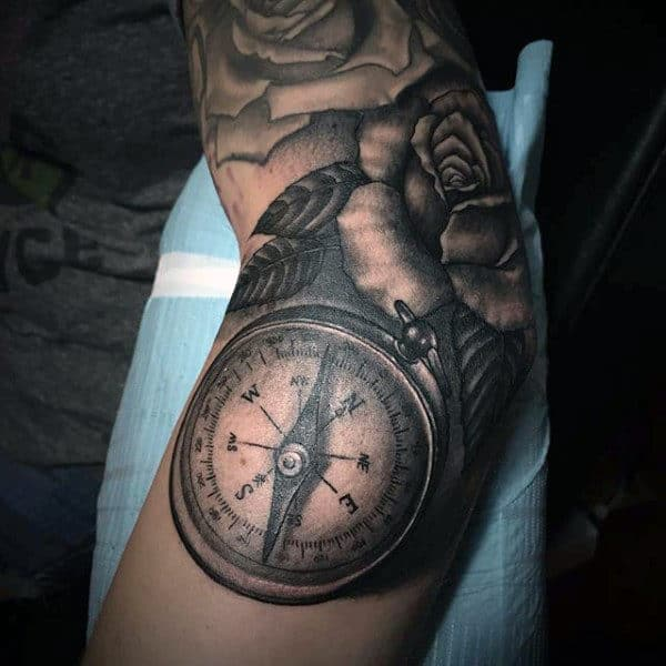 Compass Over a Blooming Rose