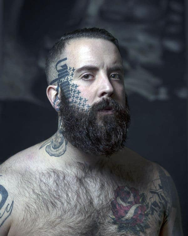 Unknown Word Plus Signs Face Tattoo