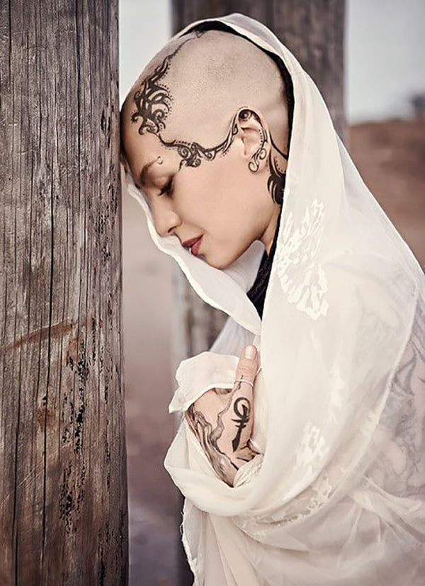 Long Faded Tribal Lines Face Tattoo