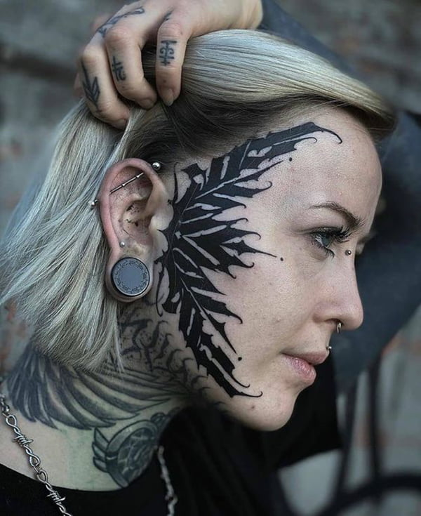 Gothic Harsh Lines Black Face Tattoo