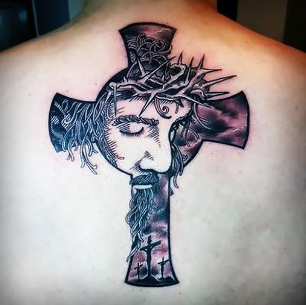 Celtic Cross with a Portrait of Jesus and the Crosses of Calvary