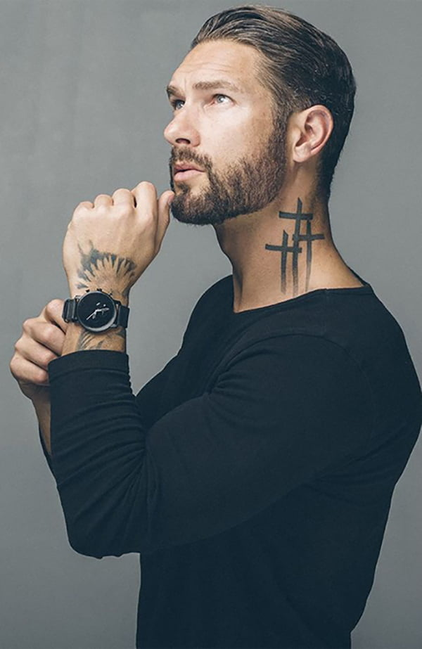 Three Simple Crosses as a Neck Tattoo