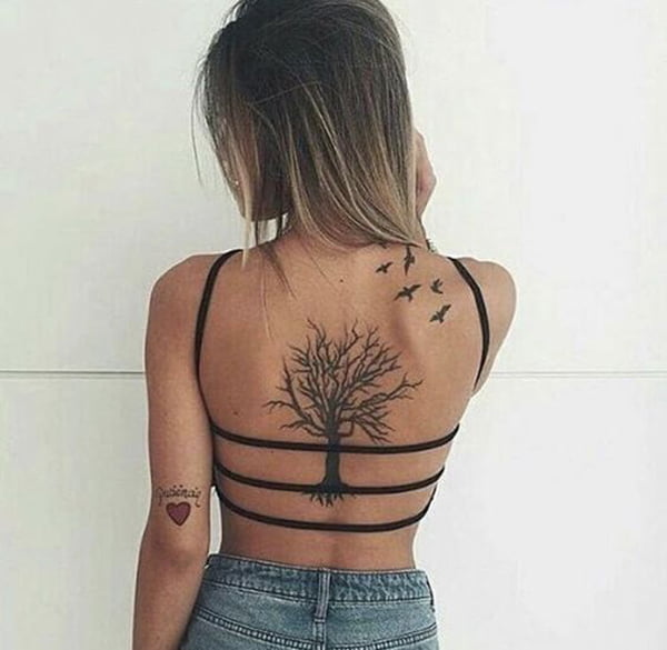 A Tree Grows Up Her Back