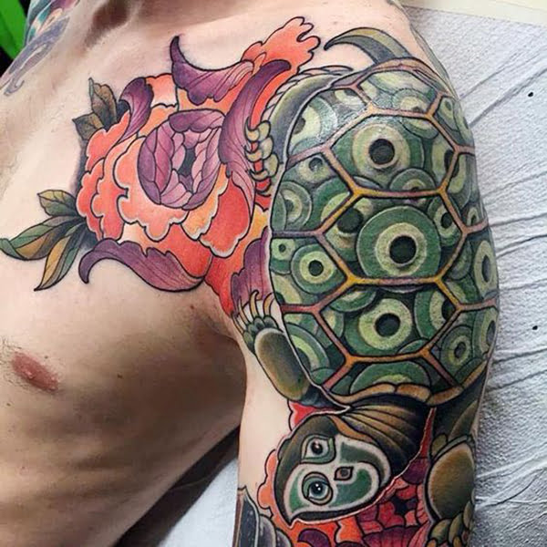 Tortoise with Multiple Eyes and a Flower